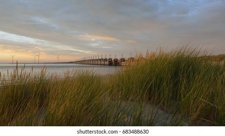 Evening sun on the Oosterscheldekering.   Seen from the Banjaard beach on the island Noord-Beveland.  Province: Zeeland, Country: Netherlands