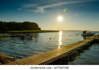 Evening sun over the lake - Kisajno lake, Masuria region in northern Poland famous for its 2,000 lakes.