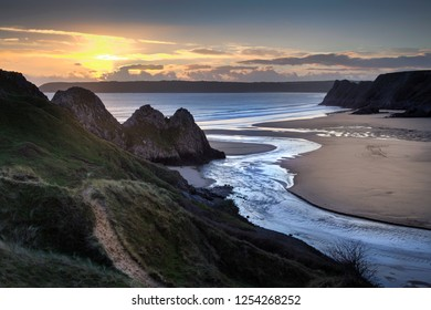 Evening sun over the river at Three Cliffs Bay, Gower, Swansea, UK