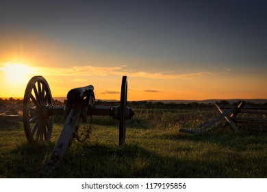 The evening sun setting on a long silent American Civil War cannon.