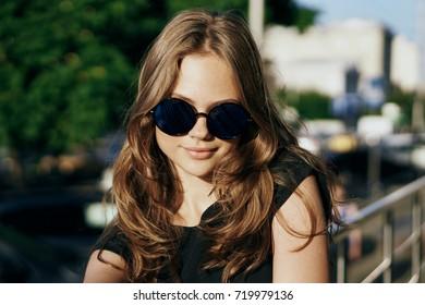 evening, sunset, city, fashionable woman in sunglasses portrait