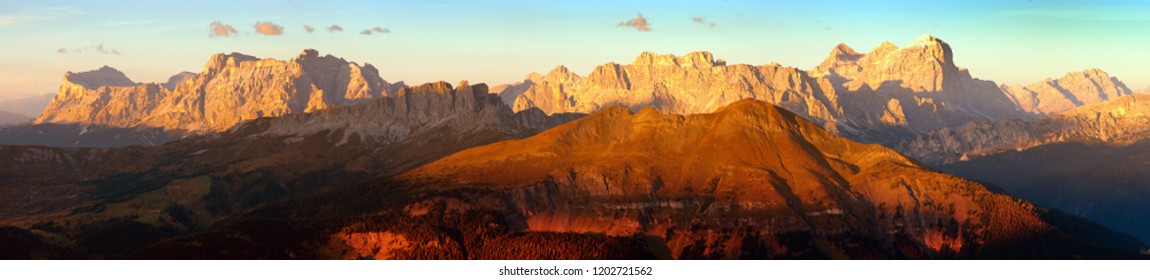 Evening sunset colored panoramic view of Alps Dolomites mountains from Col di Lana, Tofana, Fanes and others, Italian dolomites mountains, Italy
