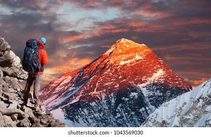 Evening sunset colored view of Mount Everest from Gokyo valley with tourist on the way to Everest base camp, Sagarmatha national park, Khumbu valley, Solukhumbu, Nepal Himalayas mountains