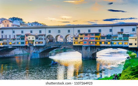 Evening Sunset Dinner Party Arno River Ponte Vecchio Florence Tuscany Italy. Bridge originally built in Roman times, rebuilt in 1345.