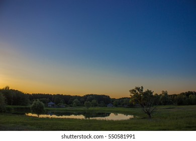 evening at sunset on the meadow Lake