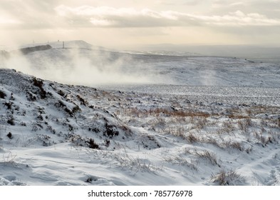 Evening sunset on a winter landscape. Thick snow on Brown Clee Hill, the highest peak in Shropshire, England, UK.