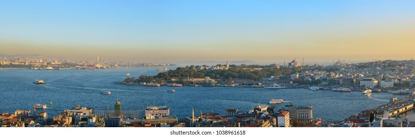Evening sunset over the roofs and sea  of the Turkish capital - Istanbul. Panoramic collage from several photos. All logos remoced.