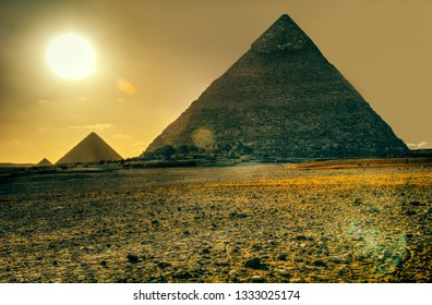 Evening sunset panorama of the area with the great pyramids of Giza, Cairo, Egypt.