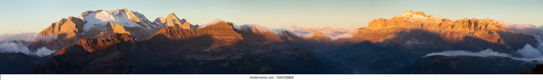 Evening sunset panoramic view of Marmolada, the highest mount of Dolomites mountains and mount Sella, Italy