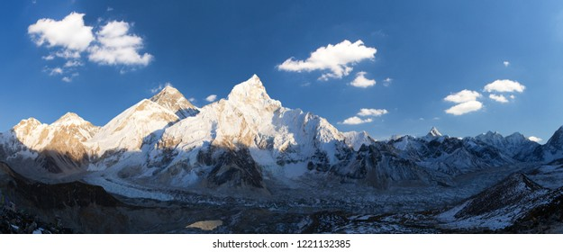 Evening sunset panoramic view of mount Everest and mount Nuptse with beautiful blue sky and clouds from Kala Patthar, Khumbu valley, Sagarmatha national park, Nepal Himalayas mountains