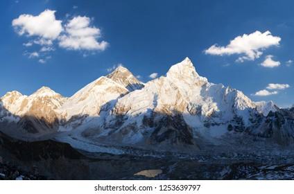 Evening sunset panoramic view of mount Everest and mount Nuptse with beautiful blue sky and clouds from Kala Patthar, Khumbu valley, Sagarmatha national park, Nepal Himalayas mountains