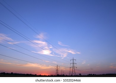 The evening sunset silhouette with electrical cable lines.