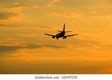 The evening sunset sky and flying away into the distance the aircraft. Heavenly landscape