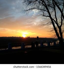 evening sunset the sun sets behind the horizon
