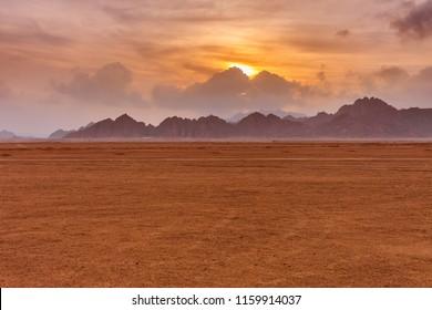 Evening sunset time near mountains at Sinai Desert, Sharm el Sheikh, Sinai Peninsula, Egypt.