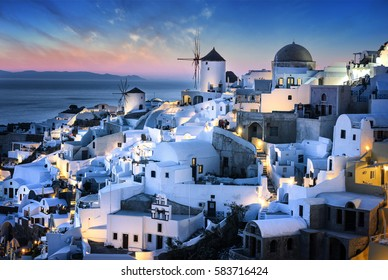 Evening time and view of Oia village on Santorini island, Greece.