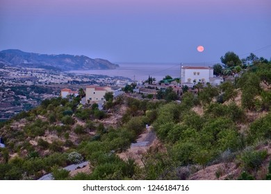 An evening in Torrox in Spain with a big moon