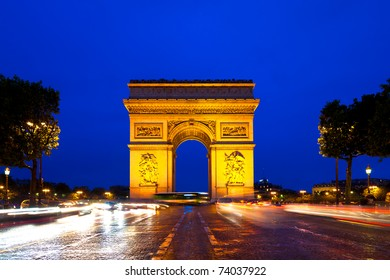 Evening traffic on Champs-Elysees in front of Arc de Triomphe (Paris, France)