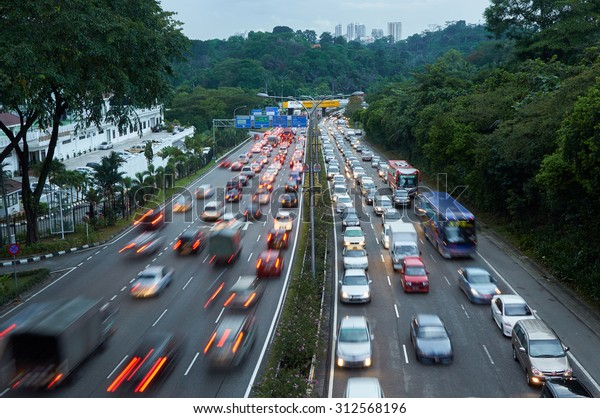 Evening traffic on the left driving road in Malaysia
