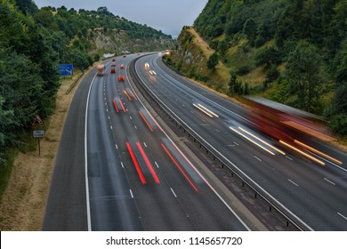 Evening traffic speeds along the M40 motorway in Oxfordshire, UK. Light trails and blurry streaks indicate the fast moving vehicles.  - Shutterstock ID 1145657720