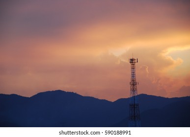 The evening twilight sky ,Antenna tower and the mountains.
