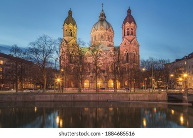 Evening view from across the Isar of the Church of St. Lukas. - Shutterstock ID 1884685516