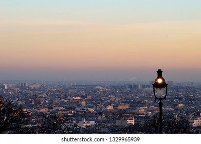 Evening view across Paris from the Basilica Sacre Coeur, Montmartre, with antique streetlamp