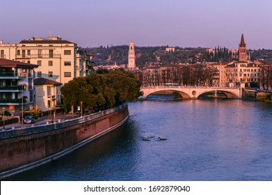 Evening view of the Adige River, the bridge and the city of Verona.