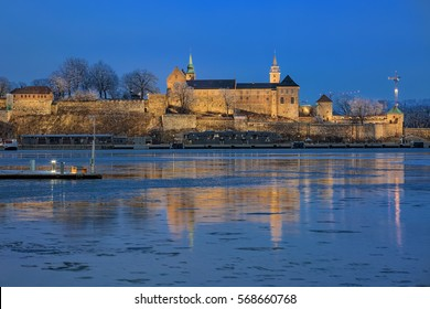 Evening view of the Akershus Fortress in Oslo, Norway. View from the Aker Brygge Marina across the Pipervika bay of Oslofjord.