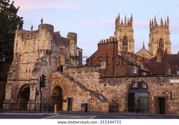 An evening view of Bootham Bar and the towers of York Minster in the background in York, England.