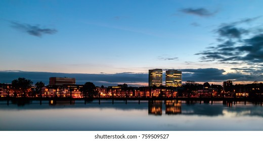 Evening view of the central railway station area with offices and luxury houses in the Dutch city of Arnhem, The Netherlands
