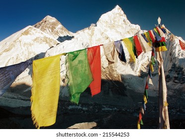 evening view of Everest with buddhist prayer flags from Kala Patthar and blue sky - way to Everest Base Camp - Nepal