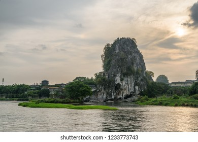 Evening view of the Fubo Hill (Wave Subduing Hill) and the Li River (Lijiang River) in Guilin, China. Wonderful landscape at sunset. Guilin is a popular tourist destination of Asia.