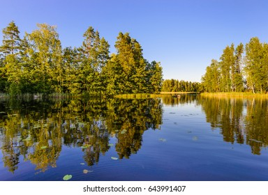 Evening view of Lake Haukivesi with reflection of trees in the water. Rantasalmi, Haukivesi lake, Saimaa lake system, Finland.