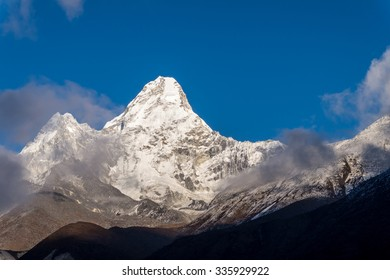 Evening view of mount Ama Dablam on the way to Everest Base Camp, Nepal. The mountain foot is already covered with shadow.