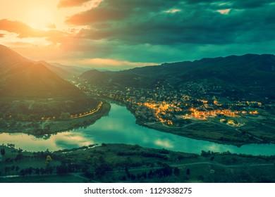 Evening view of Mtskheta city and Kura with Aragvi rivers from Jvari Monastery.  GEORGIA, EUROPE