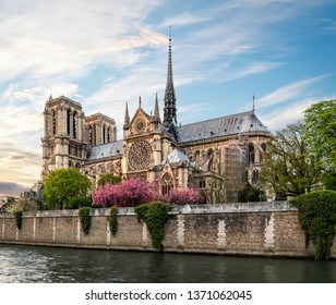 Evening view of Notre-Dame Cathedral from riverside. Copy space in sky.