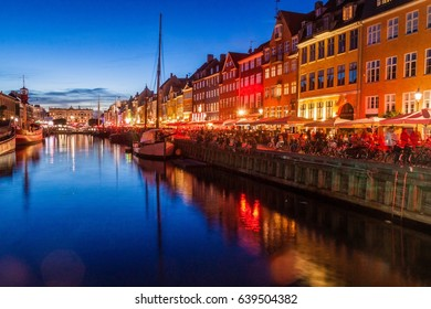 Evening view of Nyhavn district in Copenhagen, Denmark