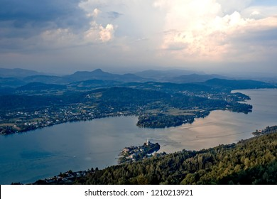 Evening view from observation tower Pyramidenkogel to mountains and lake Woerth,Carinthia,Austria