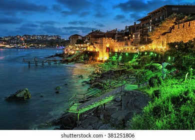 Evening view of Old Town of Sozopol (former ancient town of Apollonia) with Southern Fortress Wall and Tower in the yellow-green illumination, Bulgaria