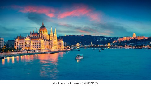 Evening view of Parliament, Chain Bridge and Buda Castle. Colorful sanset in Budapest, Hungary, Europe. Artistic style post processed photo.