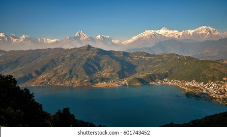 Evening view of Pokhara and Phewa lake with Himalaya mountains at the background from World Peace Pagoda in Pokhara, Nepal