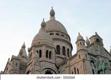 evening view of Sacre Coeur in Paris, France