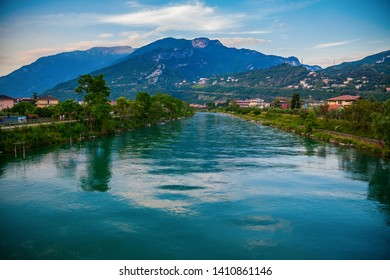 evening view of the Sarca river in a small town Torbole on the lake Garda, Italy