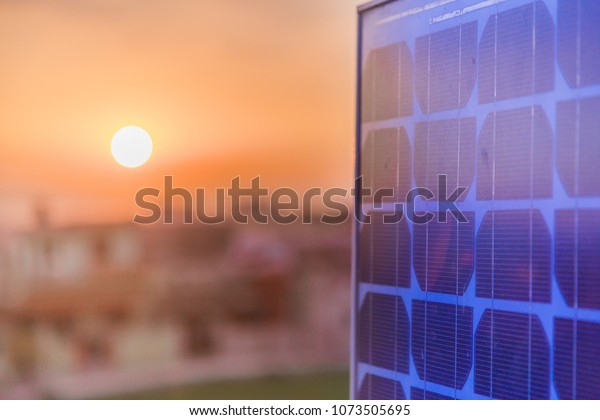 Evening view of Solar panel over roof top with city view in background.