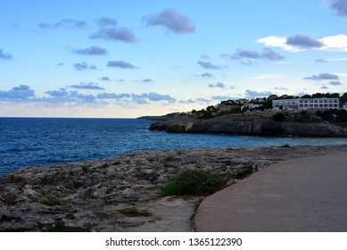 Evening view at sunset from the cliffs to the blue Mediterranean Sea near the bay and beach of Cala Domingos on the Spanish island of Majorca. Calas de Mallorca - Shutterstock ID 1365122390