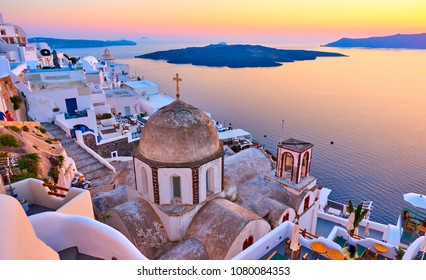 Evening view of Thira town and Aegean sea at sundown, Santorini Island, Greece