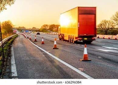 Evening view UK Motorway Services Roadworks Cones