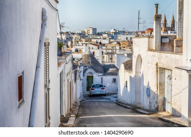 evening view at village Alberobello with gabled (trullo) roofs and white houses, Puglia, Italy