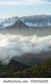 Evening view from the way to the Pico Birigoyo to the Pico Bejenado in La Palma, Spain and passat clouds in the valley.
